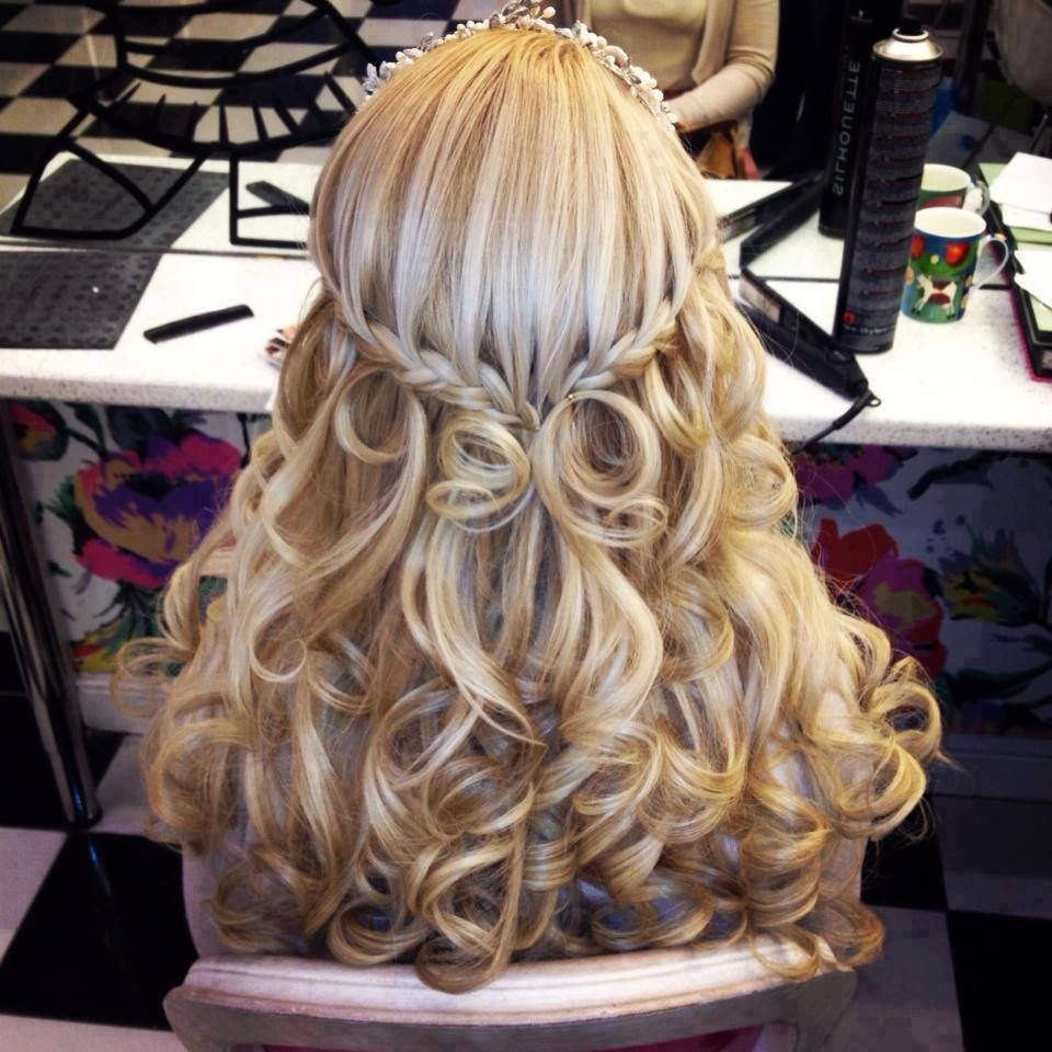 Next, curl all sections of your hair up to the braid. Spray with a light-med hold hairspray and Voila!! Beautiful hair!...for a less put together look use a larger barrel or hold curling wand in hair for less time.
