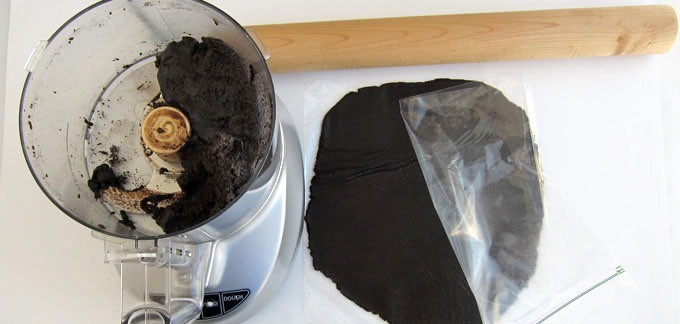 """Cut a gallon size zip top bag along two sides. Pinch off about 1/4 cup of the chocolate dough and place it the zip top bag. Roll it out to about 1/16"""" thick. Freeze for 30 minutes."""