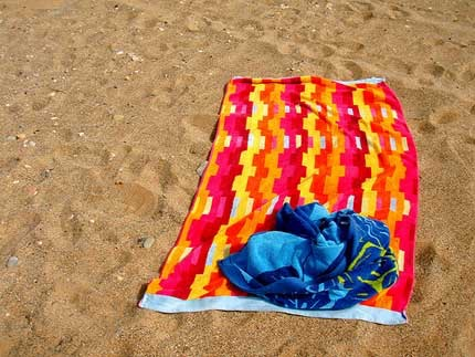Take 2 towels to your fav sandy paradise: one to lay on and another to dry your skin. You do not want to rub yourself with a scrubby towel full of sand ;)