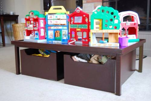 This activity table is a great way to give kids their own space to play and build and the large storage boxes underneath mack clean up a snap.