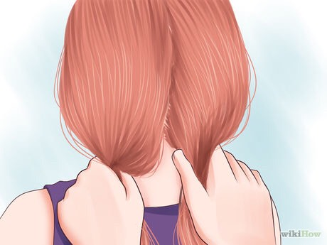Divide your hair into two sections. Comb them out so that they're tangle-free.