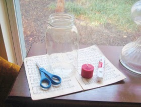 Supplies:  Mason jar (or any old jar) Twine Votive candle Old sheet music (or an old book would be great too) Scissors Glue stick
