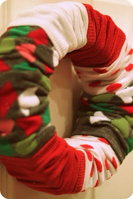 """I couldn't stop. On this one, I cut both ends of the sock and tied a leftover sock into a """"bow.""""  Can you just imagine the possibilities for all those hole-y socks now? Total cost for this craft: $2.50 per wreath (and an extra pair of socks leftover.) Not bad!"""