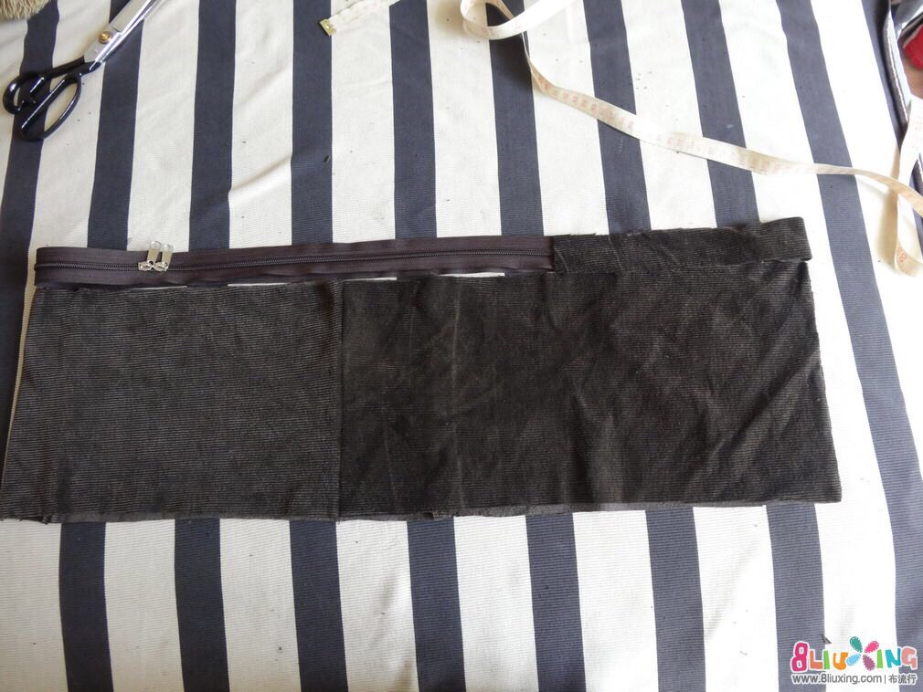 Add a zip and an extra strip of cloth which will be joined to the bag.