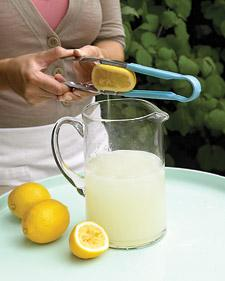 Martha Stewart suggests using tongs to squeeze the juice out of citrus fruits.