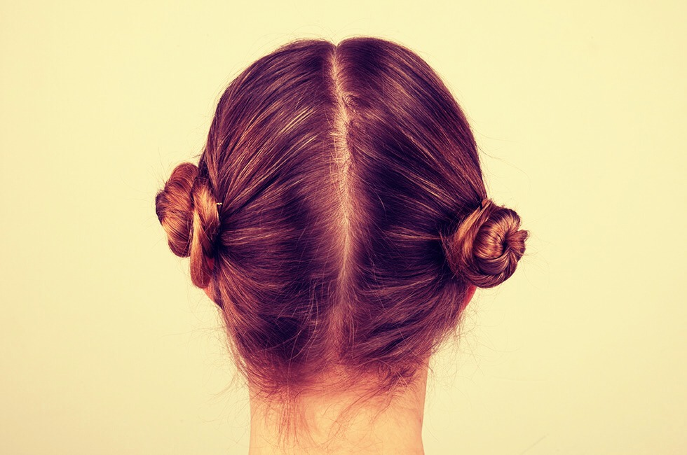 Separate your hair Twist it into 2 buns