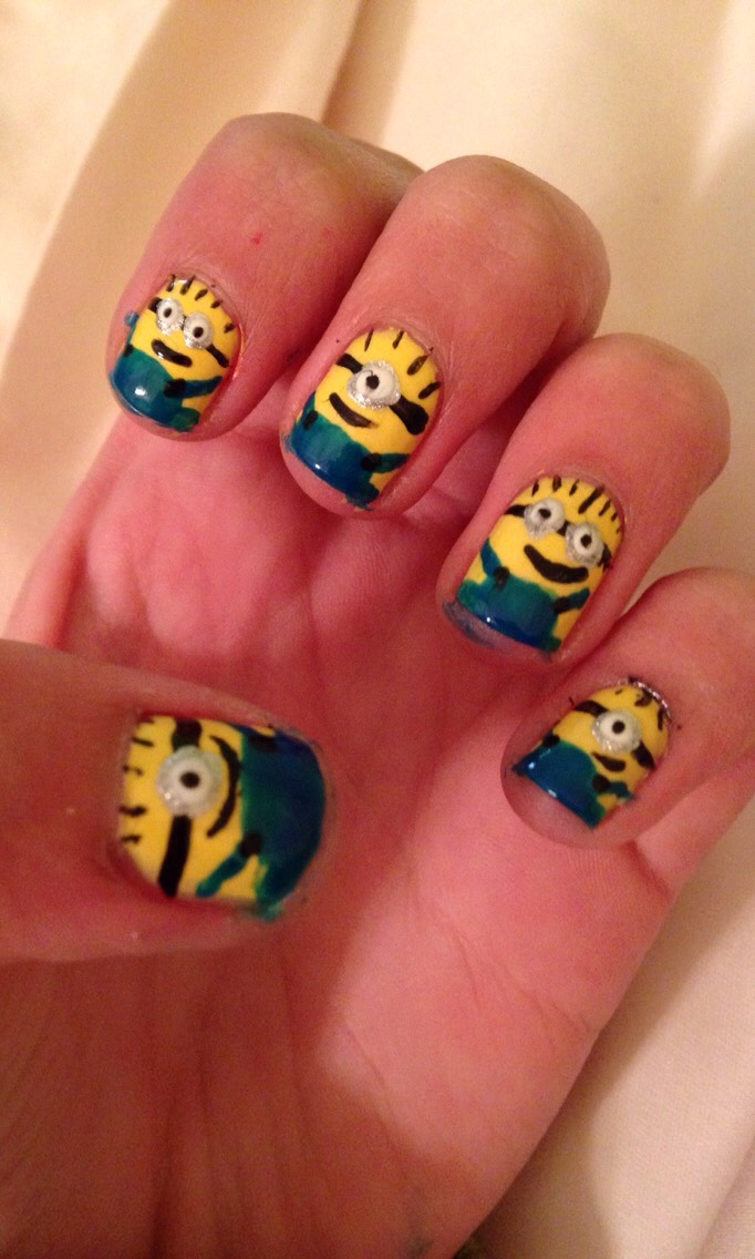 paint each nail yellow  make a dot of silver in the middle of your nail (one eye) or two side-by-side dots (2 eyes) on top of the dots, place a slightly smaller white dot, and then an even smaller black dot make a horizontal black line and a smile under the eye, with little hairs at the top