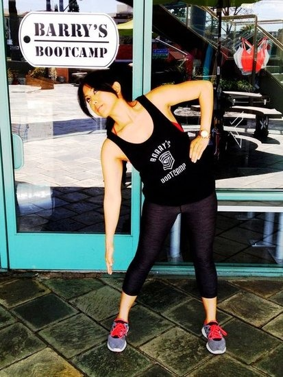 Stand with your feet hip-distance apart, arms at your sides. As you reach down towards your toes with one arm, lift the other one up towards your waist, placing your hand on your hip. Alternate sides with one arm up, one arm down.Do 100 reps.