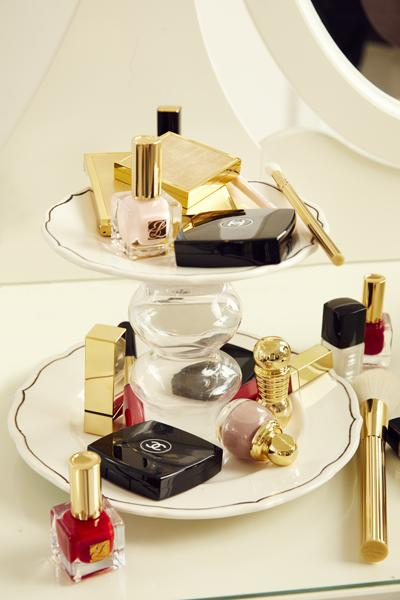 11. Makeup Storage! Your makeup deserves a swanky home. With glue, attach a candlestick holder from the dollar store between two plates. (Use a large one as the base and a smaller one on top.)