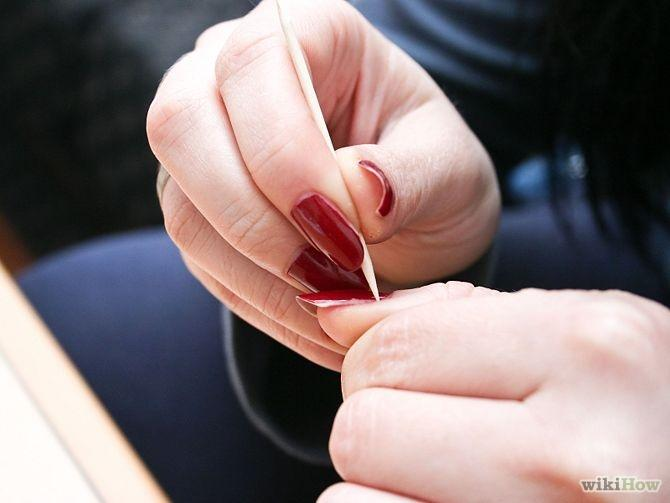 Push back your cuticles with a toothpick or a long, wooden cuticle pusher. This will help them to grow faster, Be sure you have a basic knowledge of doing this correctly before attempting it.