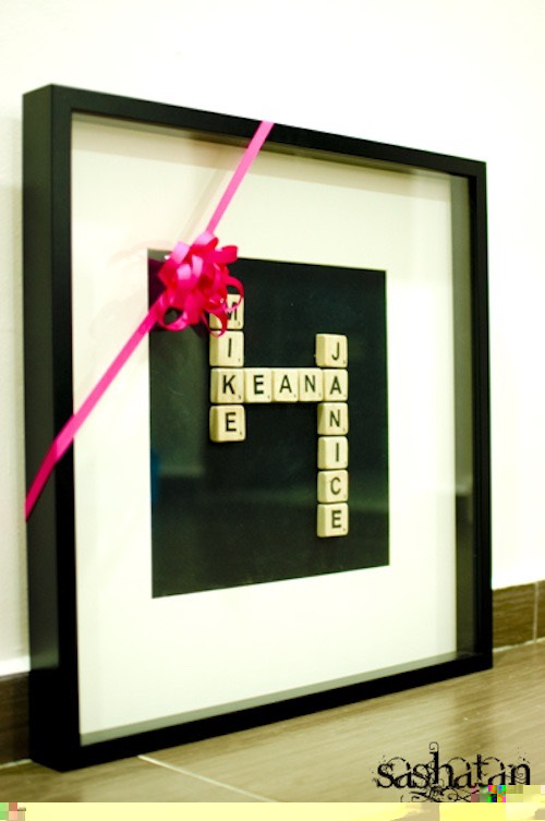 33. Framed Scrabble Tiles I just plain like the idea of using scrabble tiles, I guess they are my new obsession next to wine corks. You could frame them with a quote, family names, or anything else you'd like. Such a neat gift idea!