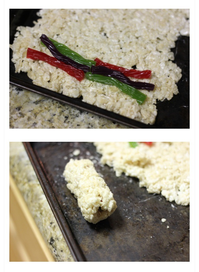3. For roll: place twizzlers or other flexible candy at the edge of the rice cereal mixture.  Wrap and roll, to a sushi roll shape.
