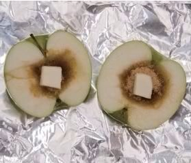 Halve an apple and hollow out the core. Fill with brown sugar and a pat of butter. Wrap in foil, bake, and enjoy! Try with ice cream too. Yum!