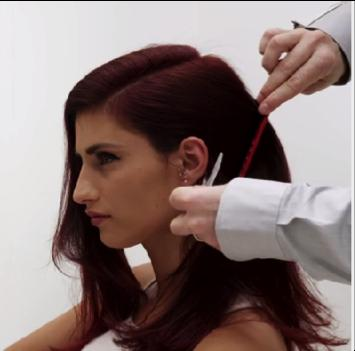 (5) Create a deep side part and smooth out the hair. (6) Secure the lower section of hair back with a duck bill clip.