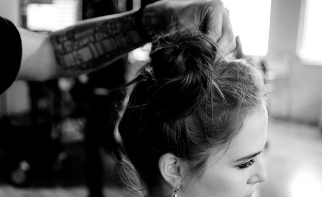 Pin  Once you've spun all of your hair into a bun, pin it in place, using the same bobby pin technique—the first pin goes down into the bun, and the rest cross it.