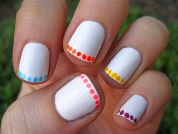 * For a simple, yet adorable look, paint your nails white, then apply small colorful dots and the edge of your nail.