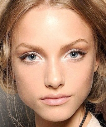 Use White Shadow - You actually don't have to smear your eyelids with white shadow if you're learning how to make your eyes look bigger. Use a pencil or a shadow to dot some white right against the inner corners of your eyes. That will make the whites look brighter and it will open up your eyes