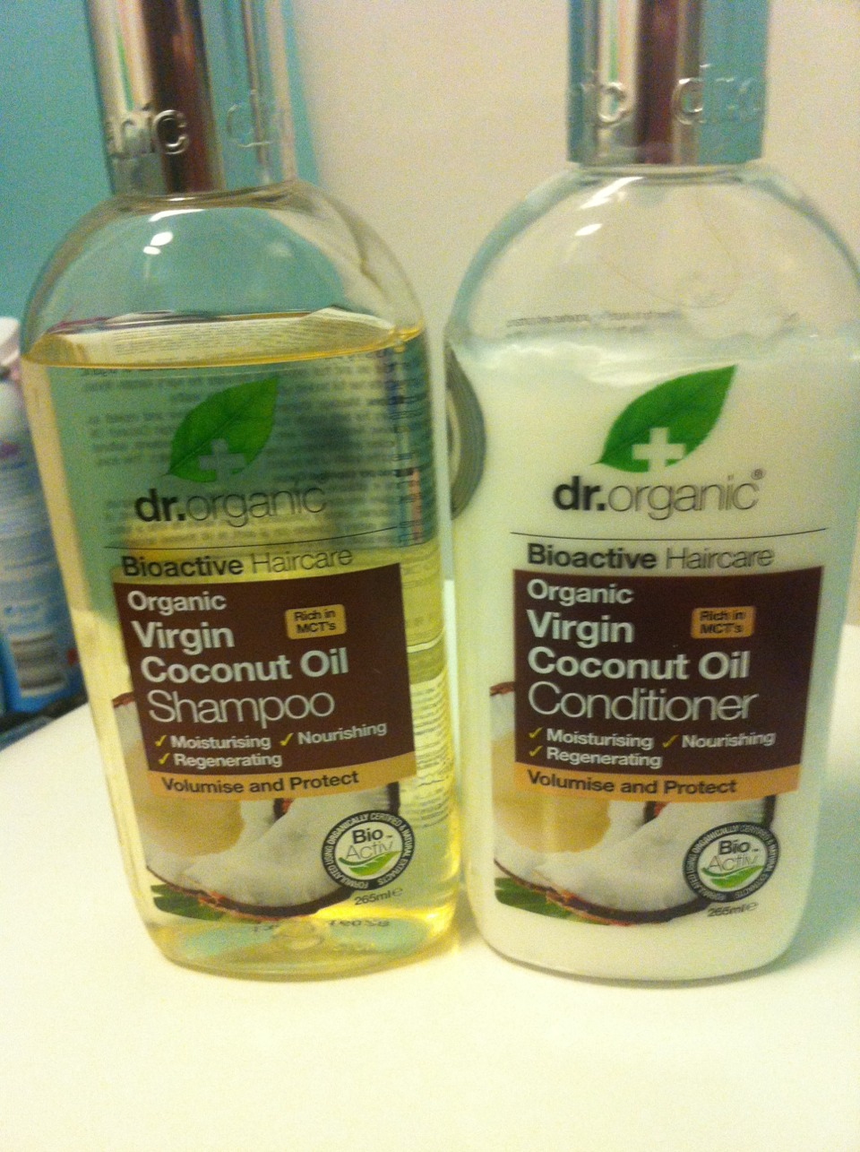 Virgin coconut oil had many uses, instead of putting the actual grease/oil into your hair, using shampoos/conditioners can help just as much and will not cause extra hassle   Dr organic has a number of different shampoos and conditions, virgin coconut oil helps with your hair a fair bit more.