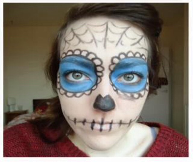Step 6.  -Final use of the black eyeliner is to create the spooky skull nose -Start by  drawing a v in the middle of the nose and bring them around to the bottom of your nose. -Colour this in all black⚫️