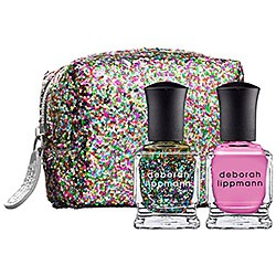 Deborah Lippmann Best of Both Worlds Pop Rock Mini Duet   Perfect for the girly girl who loves a little sparkle and shine! The ideal shade of bubble gum pink and confetti sparkle to ring in the New Year. And how cute is the little sparkly tote it comes in.  Get it at Sephora $19