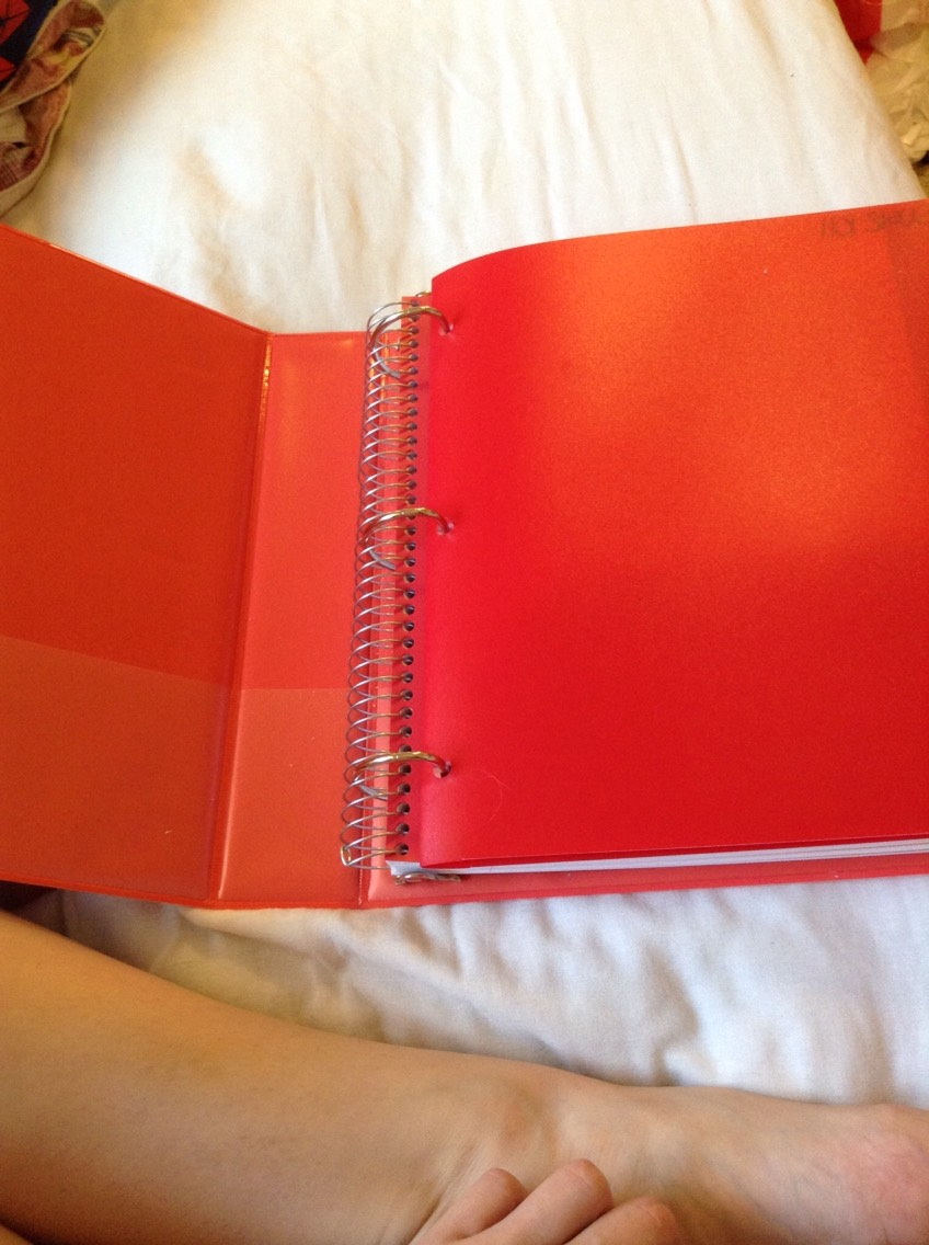 A one and half inch binder with a folder full of paper and a five subject note book. I have two of these