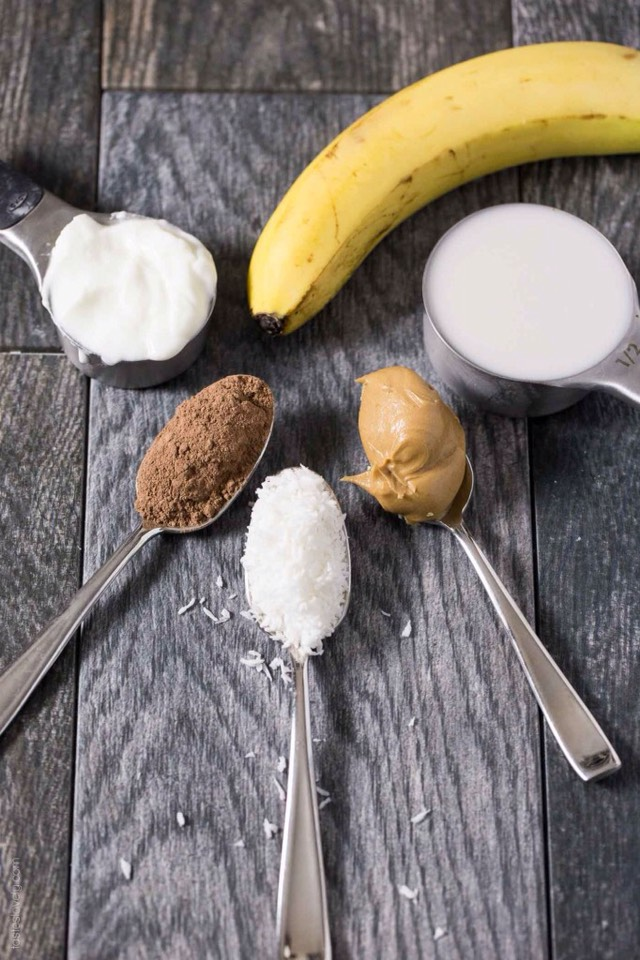 Ingredients •1 cup ice •¼ cup coconut flavored almond milk •¼ cupVanilla Lowfat Yogurt •1 medium size banana •2 tablespoonsPeanut Butter •2 tablespoons unsweetened coconut flakes •1 tablespoon unsweetened cocoa powder.