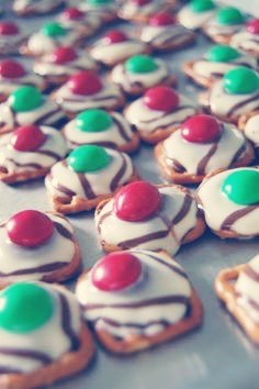 Step 4: Place 1 M&M on each chocolate pretzel so it looks like the picture above.  And boom its complete!This snack is so simple and delicious.  You can give it to someone as a gift or eat them for yourself! Hope you like them!
