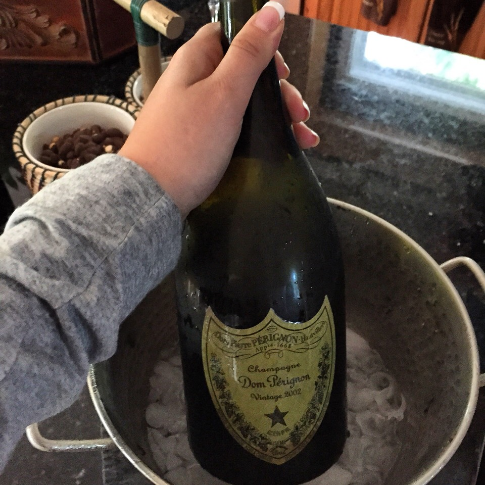 7. Drink an expensive bottle of wine, hopefully on your parent's expense! (Pictured: $300 bottle of champagne)