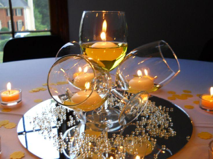 wine glasses, floating candles, small crystals and a metal plate = great centre piece
