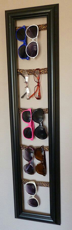 #7 Sunglasses Board  Display your sunglasses on an old frame. Stick cardboard or strings on the back of the frame and hang sunglasses.