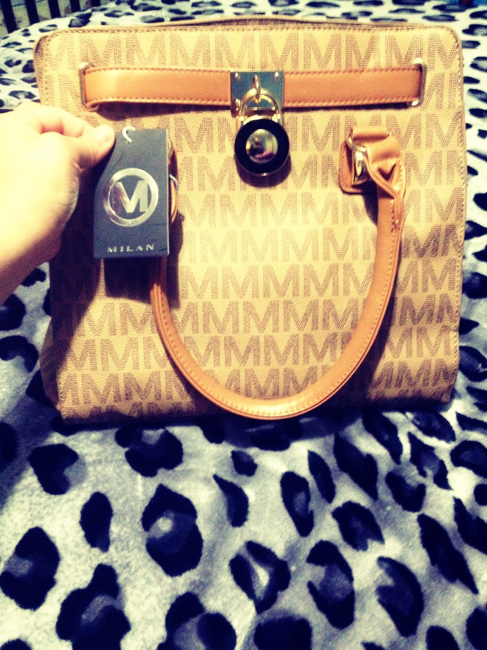 This is my MILAN purse got it for $60 Its a realy realy nice purse plus elegent. It in a vanilla color realy nice .! Comes with a long strap as well . You can find it on eBay and Amazon