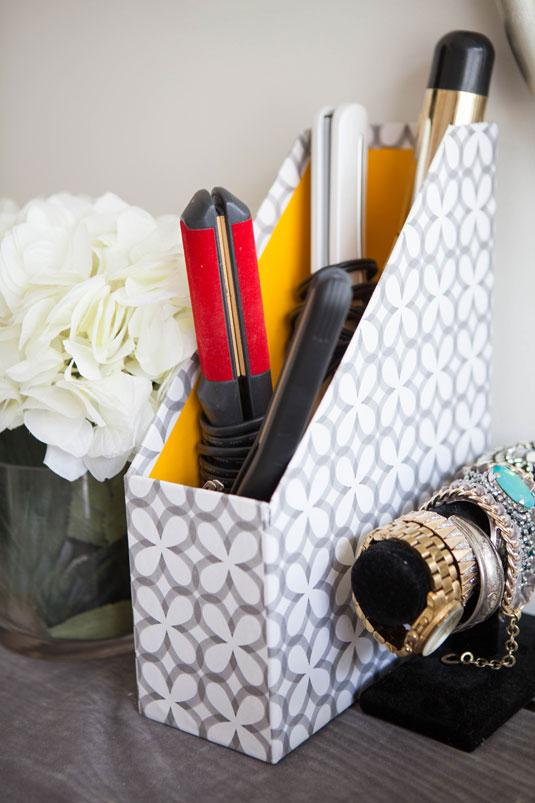Store your hot tools inside of a decorative magazine holder.