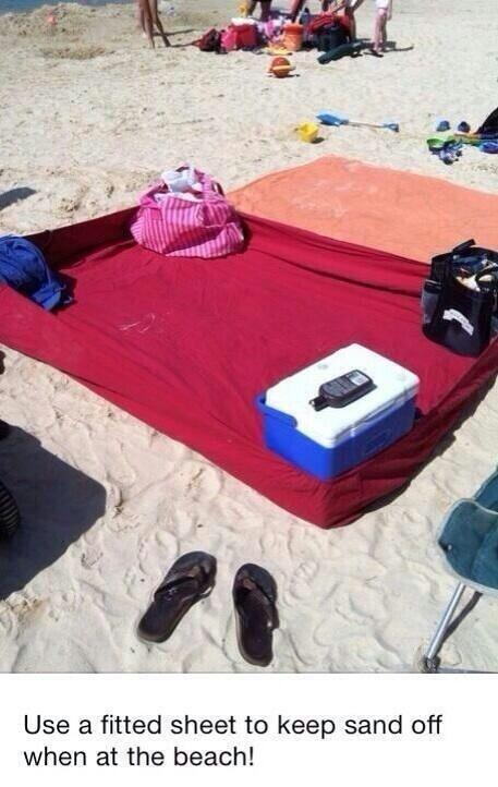 A fitted sheet can become the best thing to happen to your vacation.  Just make sure you have realistic expectations here: it is the beach after all. This hack is best for those wanting a clean space to have lunch on before playing in the sand.