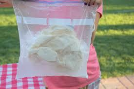 take out the smaller bag and eat ice cream right out of the bag or put it into another bowl.