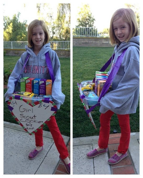 A Tupperware tray and some duct tape makes a great cookie carrier for your little girl scout.