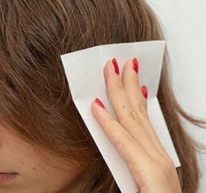 Then, Take the dryer sheet and rub it all over your hair. It will instantly de-frizz your hair!
