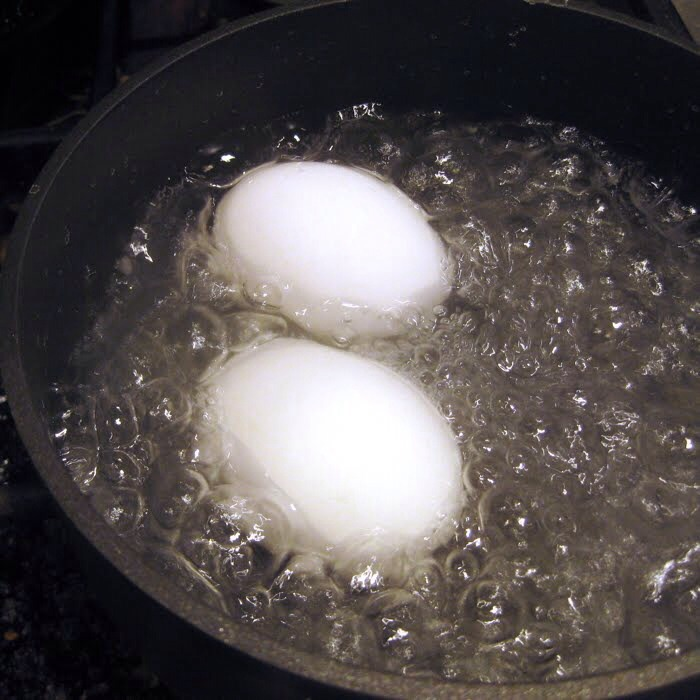 Add eggs when  the water is at boling point. And then wait for 10 minutes.