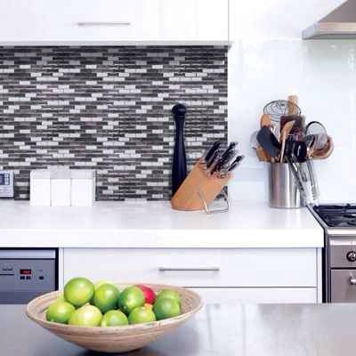 28. Update your kitchen backsplash by using 3D gel-like tiles that are actually peel and stick.