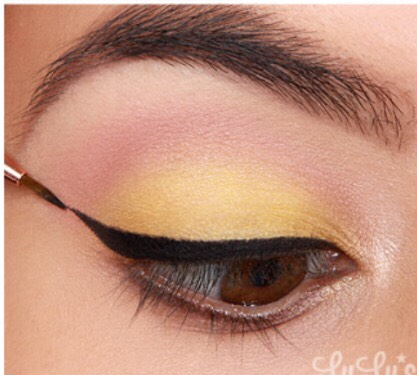 6. Carefully create a sharp cat-eye using a thin eyeliner blush and a liquid eyeliner.