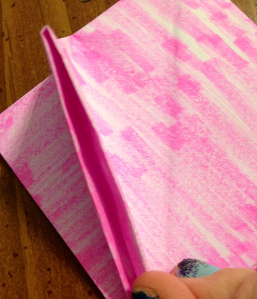 Pick up the first layer at the corner and you will notice an opening like this
