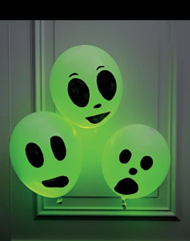 Just add a glowstick to a white balloon, paint it with a sharpie and voila...perfect Halloween decoration