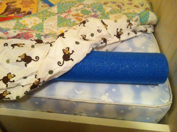 Place a pool noodle under the fitted sheet for a easy bed buffer