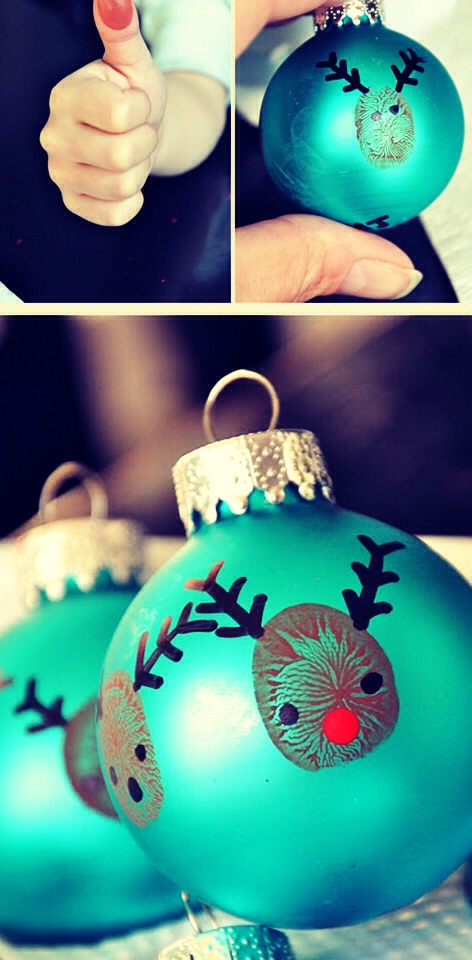 Do a brown thumbprint and put it on an ornament. Draw eyes, nose, mouth, and antlers. Easy, adorable Christmas decorations that the kids can make theirselves! My son loves doing a new one every year!