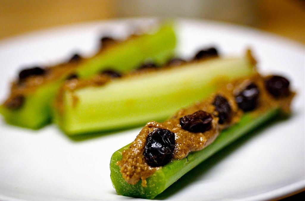 This is a classic....yep you guessed it. Ants on a log. It is pretty self explanatory. A piece of celery coated with peanut butter and topped with raisins. YUM!