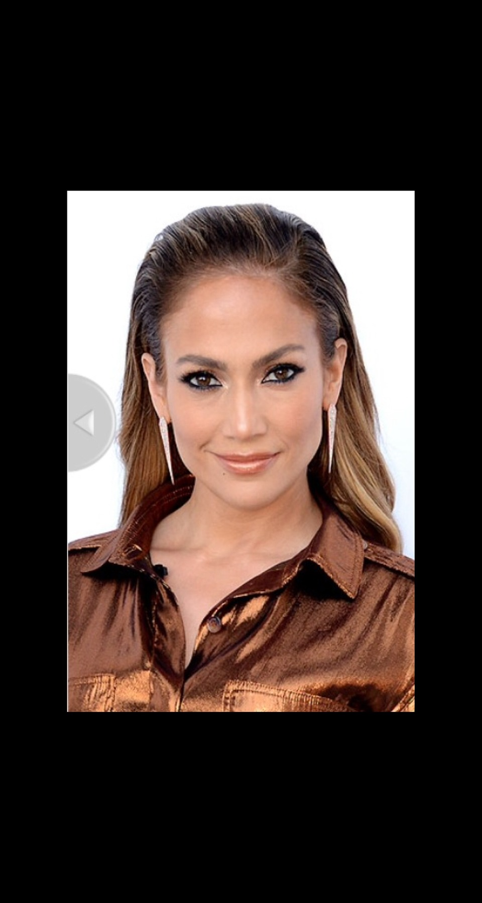 """COMBED-BACK, BUT NOT SLICKED-BACK HAIR The """"air headband"""" look isn't new, but it's what Jennifer Lopez and Jennifer Lawrence are leaving out of the equation that made us fall in love with this fresh take on the hairstyle: They didn't load up on hair gel."""