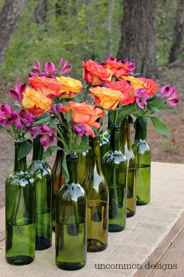 A Simple Centerpiece The team at Uncommon Designs details how to make a simple centerpiece from collected and cleaned green wine bottles.
