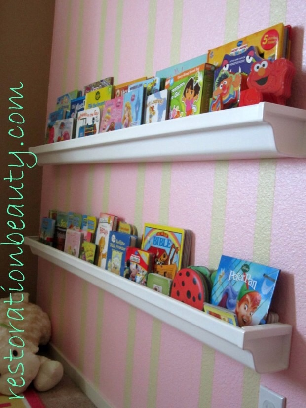 Use rain guards for a house or garage to  Hold books in the kids room instead . Takes away from having too much space taken up by a book shelf .
