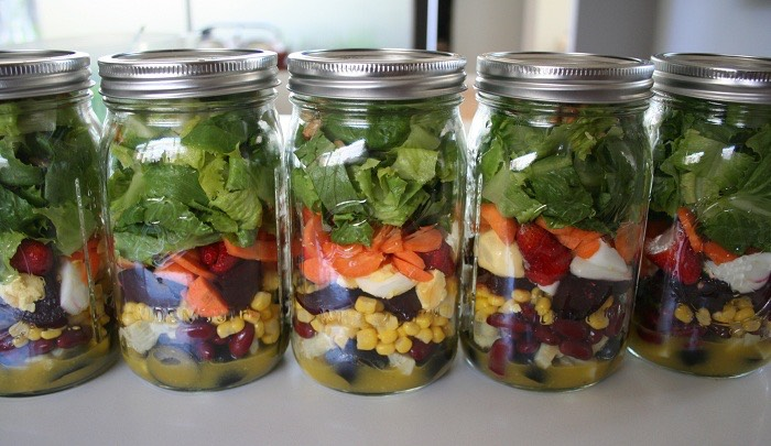 make a layered salad for lunch everyday!  Layer your favorite salad fixings in the jar. Keep the lettuce at the top so it doesnt get soggy and dressing on bottom. A light balsamic vinegarett is a flavorful way to avoid extra calories from creamy dressings.