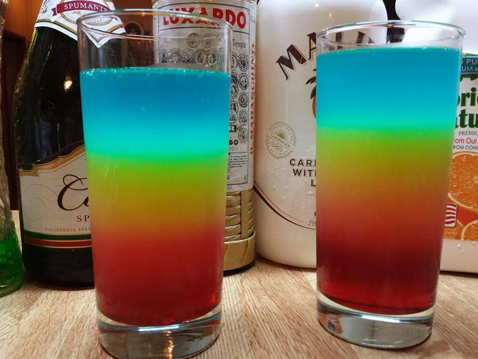 THE SIX CYCLE  1 1/2 oz. (45 ml) White Rum 1/2 oz. (15 ml) Maraschino Liqueur 2 1/2 oz. (75 ml) Orange Juice 1/2 oz. (15 ml) Grenadine 1/2 oz. (15 ml) Blue Curacao 2 1/2 oz. (75 ml) Champagne