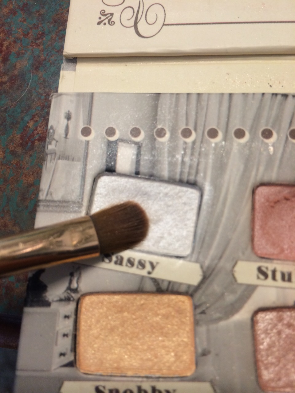 This last step is optional. Take a white eyeshadow and apply it to the inner corner of your eye (again, with the same brush). Also, if the result is too dark for your liking, you can apply a very thin layer of white over everything to lighten it up. I do not usually do this last step.